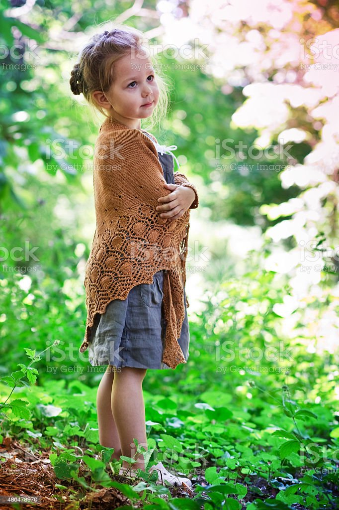 Girl in a brown knitted shawl stock photo