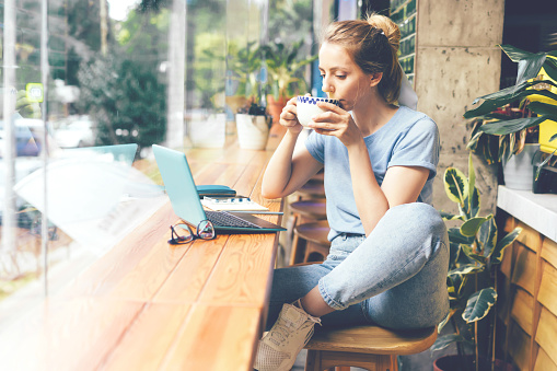 Girl In A Cafe With A Laptop Stock Photo - Download Image Now