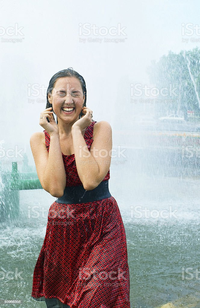 girl in a city fountain royalty-free stock photo