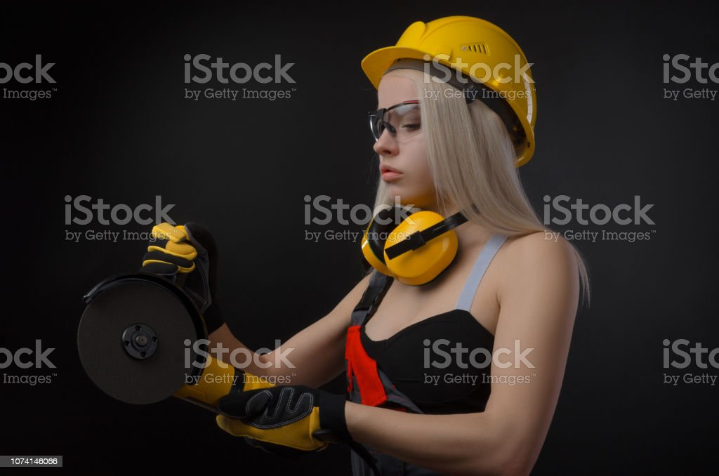 the girl in a construction firm works with a tape measure