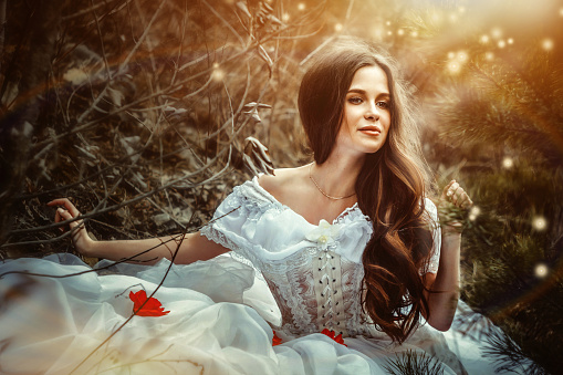 Girl In A Dress Sitting In The Woods Stock Photo - Download Image Now