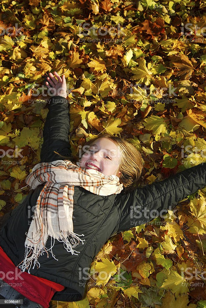 Girl in a fall park royalty-free stock photo