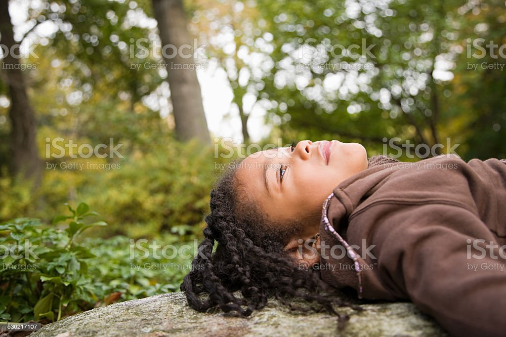 Girl in a forest stock photo