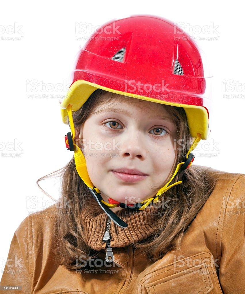 Ragazza in un casco foto stock royalty-free