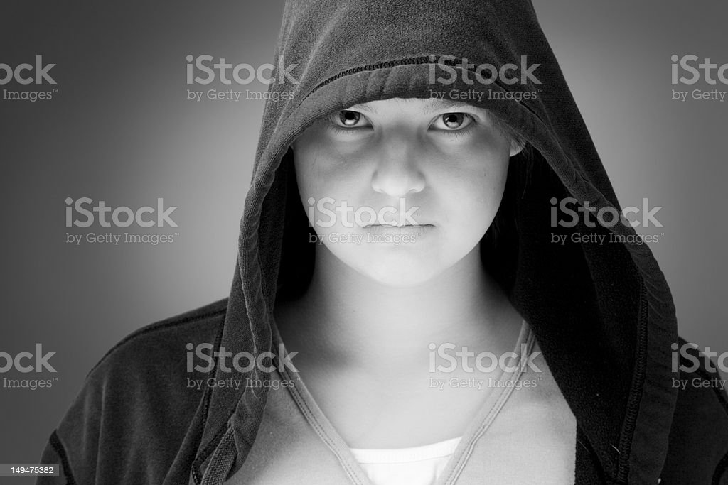 Girl in a hooded jacket stock photo