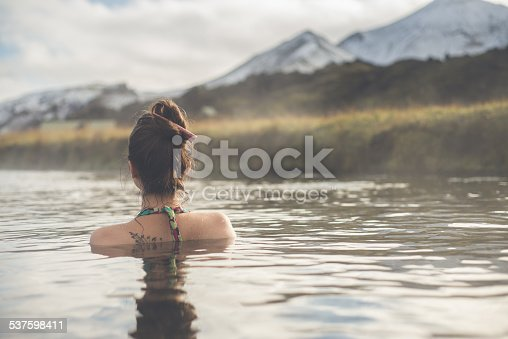 Beautiful girl in a hot spring.