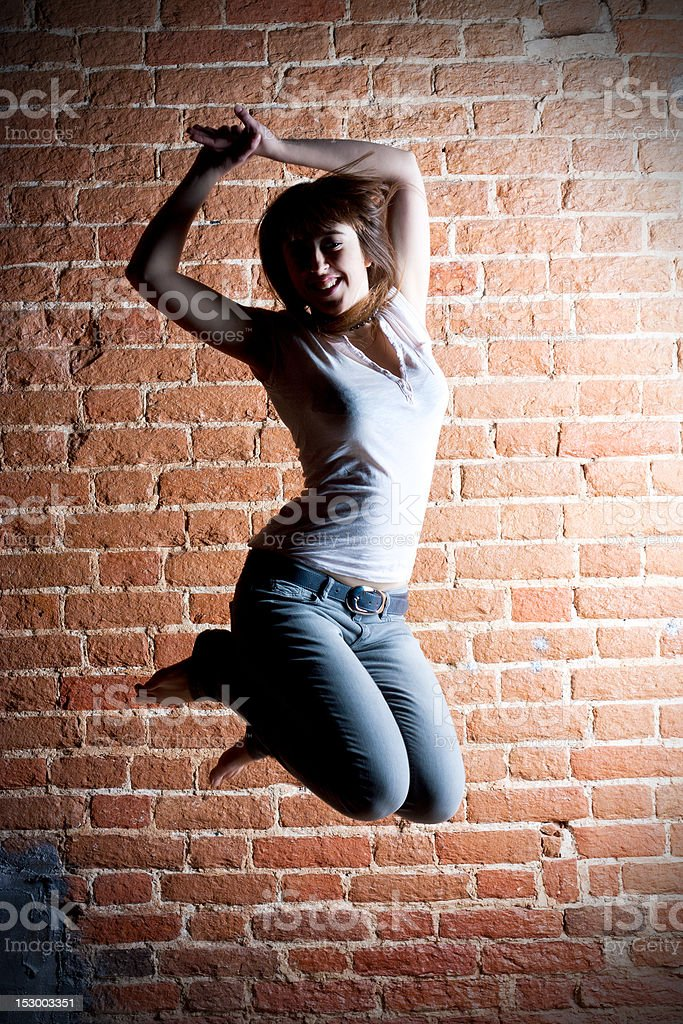 Girl in a jump stock photo