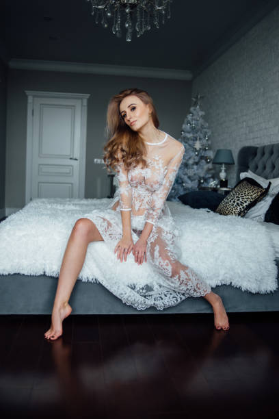 Cтоковое фото A girl in a lace dress on a bed