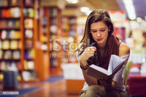 istock girl in a library 452406305