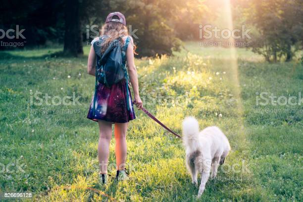 Girl in a park with her dog picture id826696128?b=1&k=6&m=826696128&s=612x612&h=zx8bptekuklhvhjpm1pfu7wr8ir0zjinv2kyifkmebc=