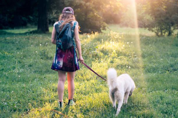 Girl in a park with her dog picture id826696128?b=1&k=6&m=826696128&s=612x612&w=0&h=dlqwhp5wo3whn3oturri qpzuqev3kpbgnlcktlalgc=