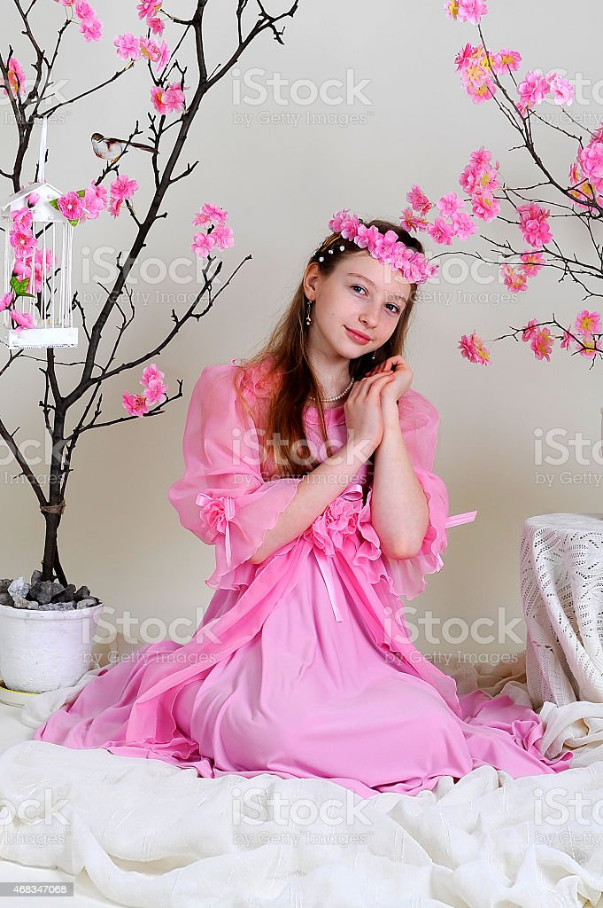 girl in a pink dress and wreath royalty-free stock photo