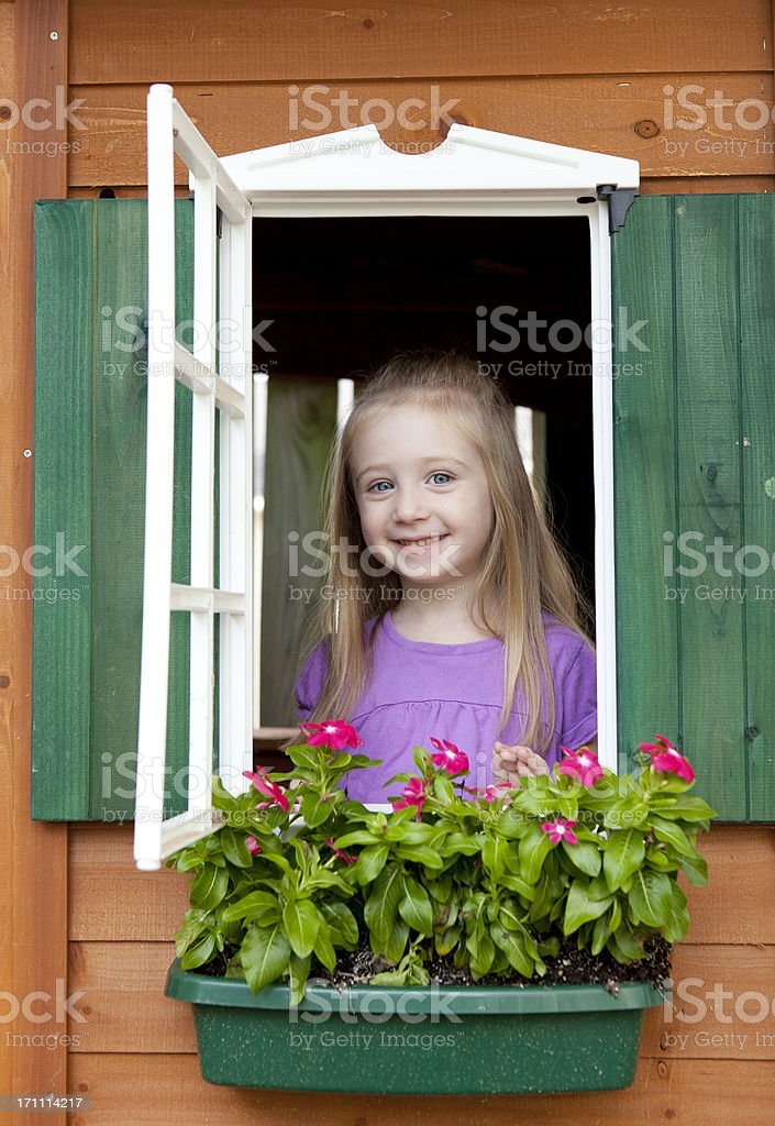 Girl in a Playhouse Vertical stock photo