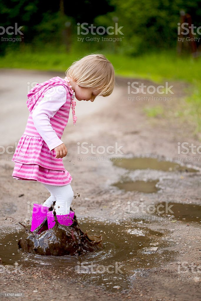 Girl in a puddle royalty-free stock photo