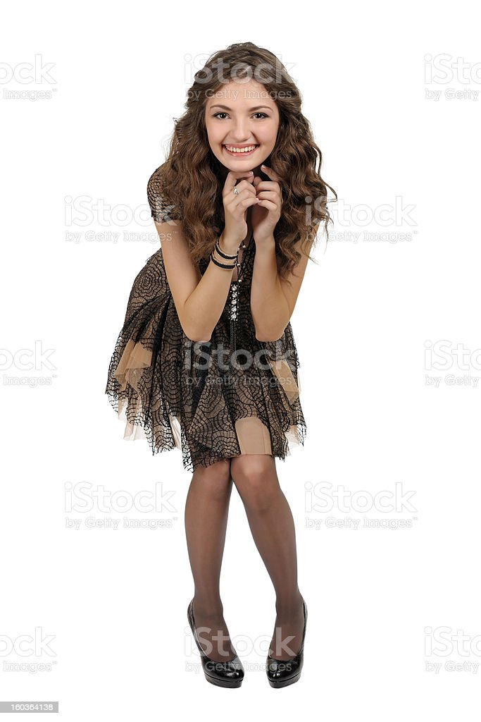 Girl in a short black dress. royalty-free stock photo