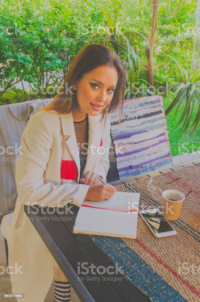 girl in a summer cafe with glasses, summer morning - Royalty-free Adult Stock Photo