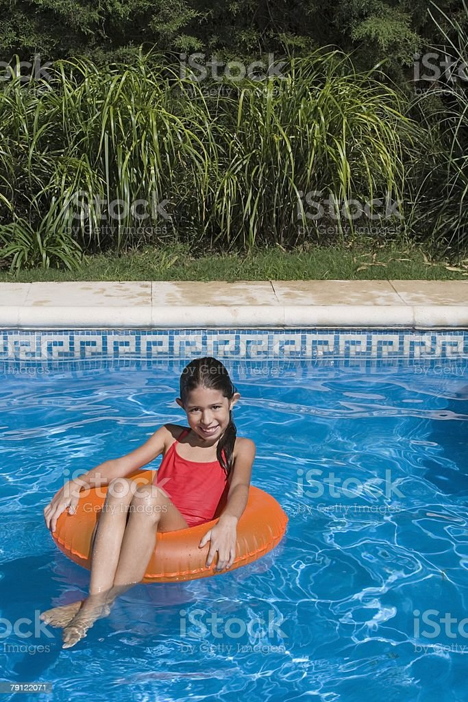 Girl in a swimming pool royalty-free stock photo