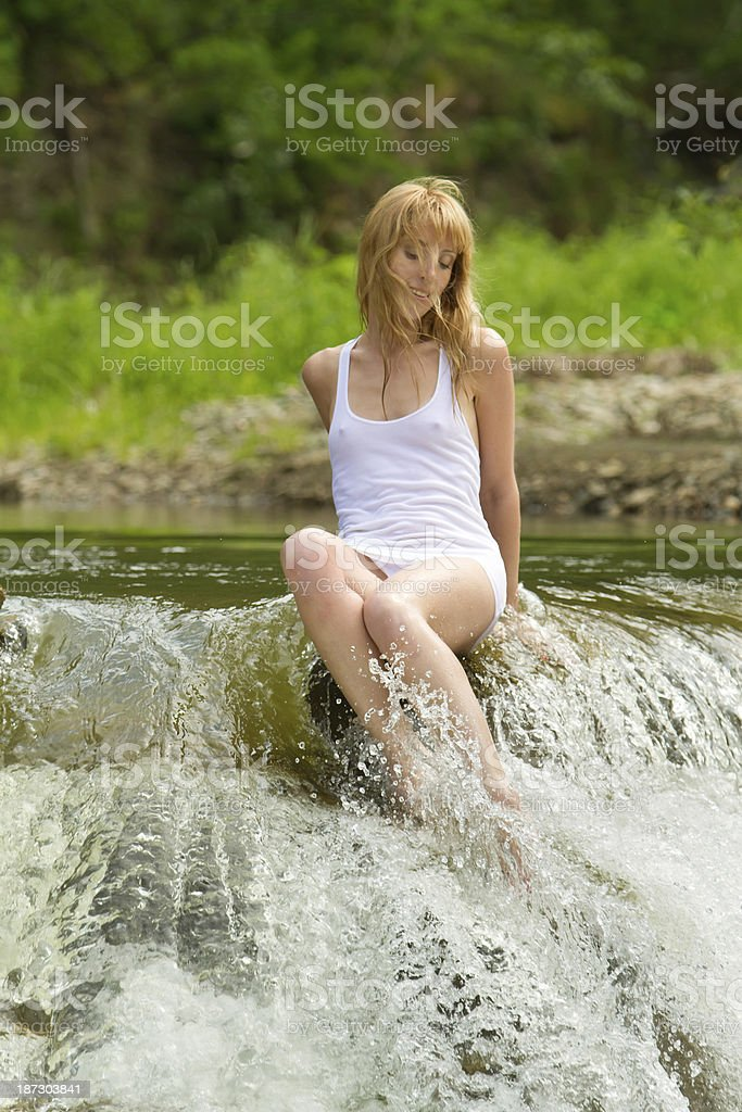Girl in a white T-shirt stock photo