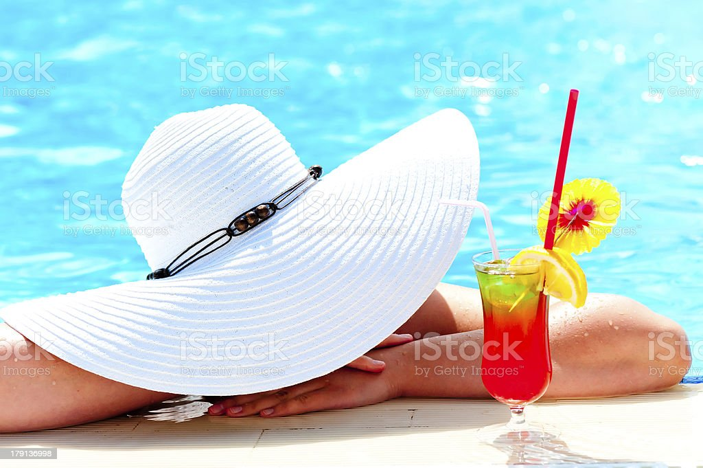 girl in a wide white hat resting  the pool royalty-free stock photo