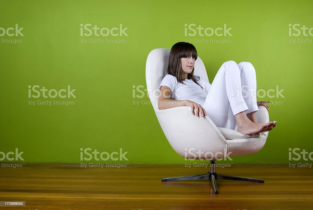 Girl In All White Chair stock photo
