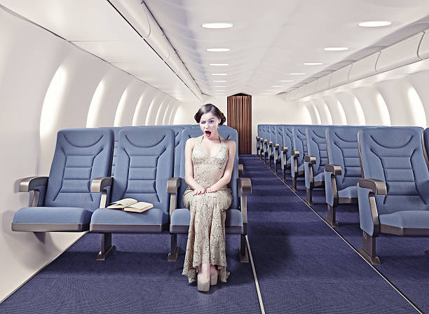 Girl in an airplane Surprised girl in an airplane. Creative concept. photo and CG elements combinated airplane seat stock pictures, royalty-free photos & images
