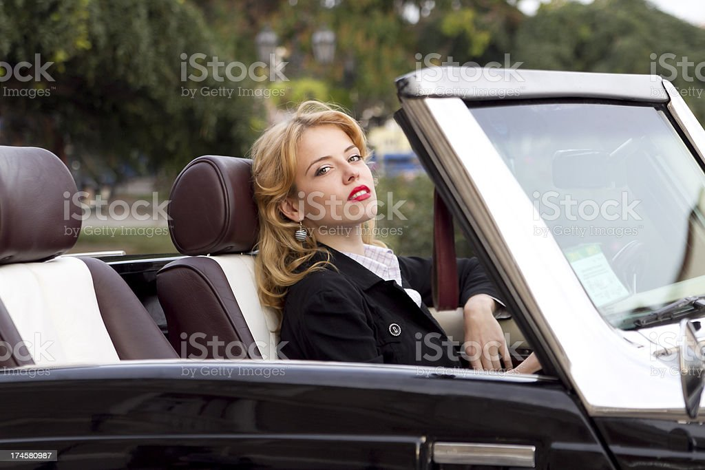 girl in an old car stock photo