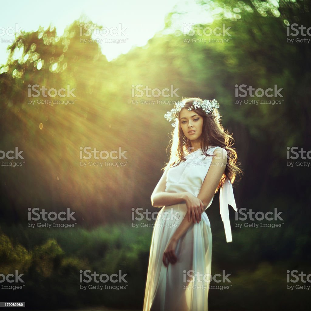 A girl in an old fashion wedding dress stock photo