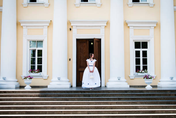 girl in ancient dress with crinoline on the background of the building with columns - petticoat stock pictures, royalty-free photos & images