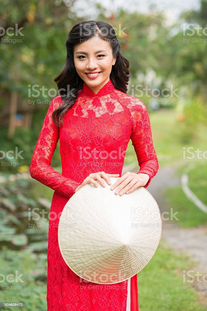 Girl in ao dai dress stock photo