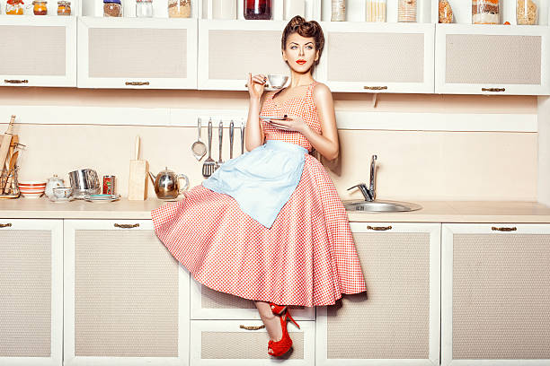 girl in apron - pin up girl stock pictures, royalty-free photos & images
