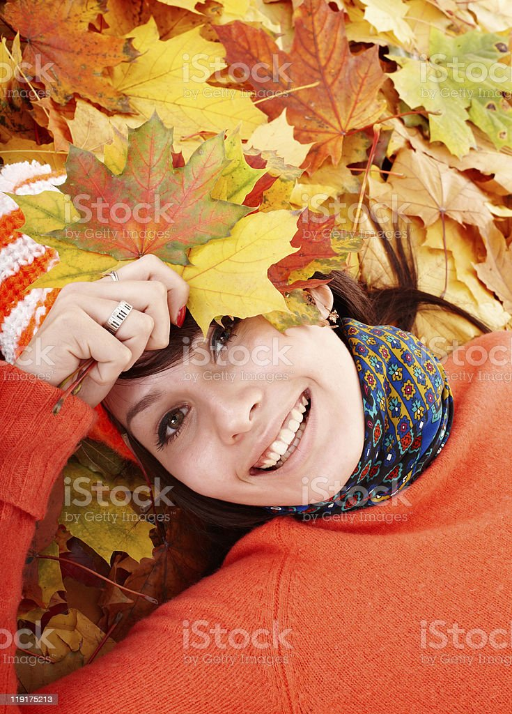 Girl in autumn orange leaves. royalty-free stock photo