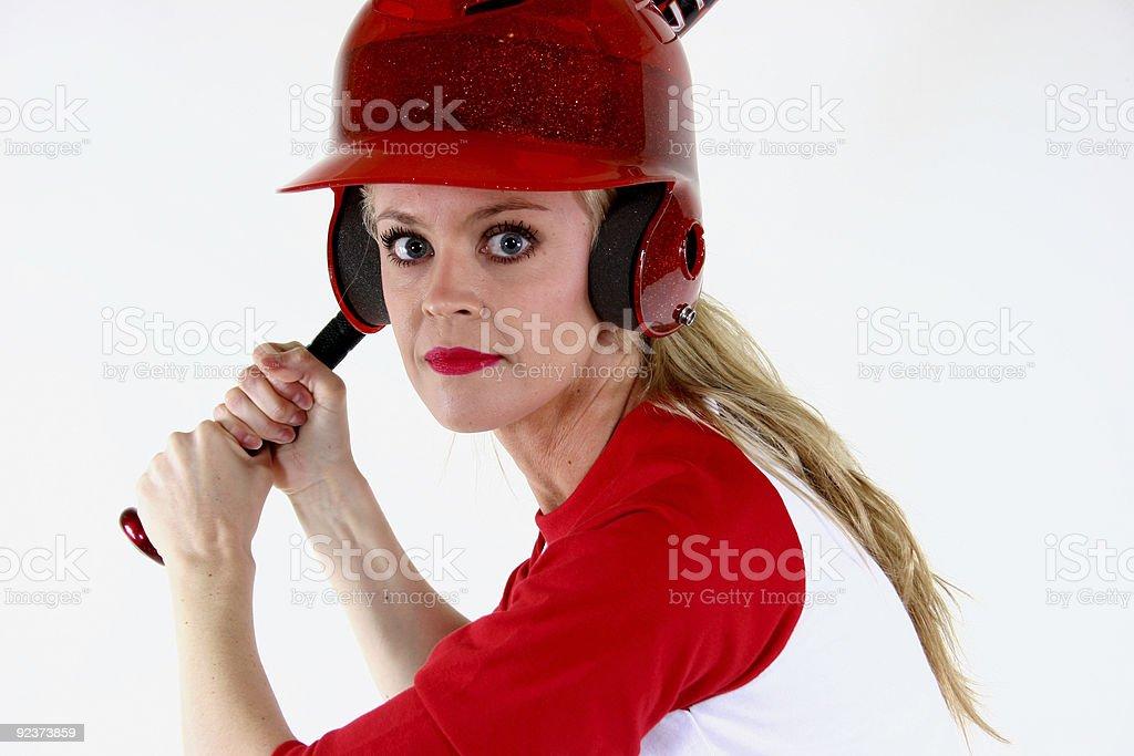 Girl in baseball uniform with bat royalty-free stock photo
