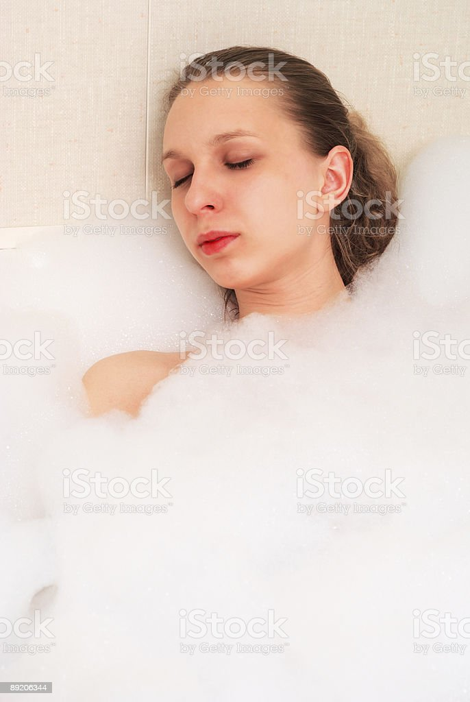 Girl in bath foam royalty-free stock photo