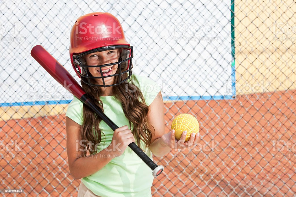 Girl in batting cage royalty-free stock photo
