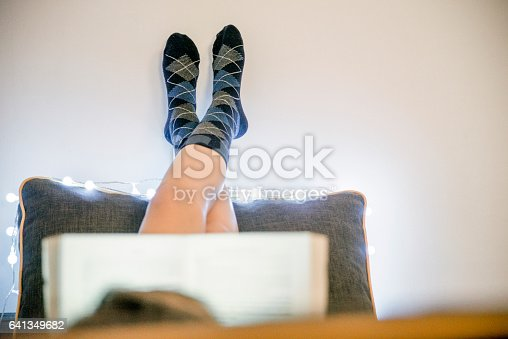 501914364istockphoto Girl in bed reading a book 641349682