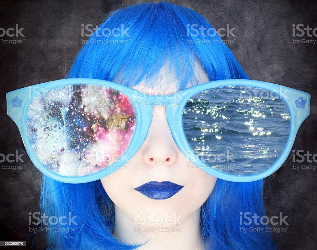 Girl in big eyeglasses stock photo
