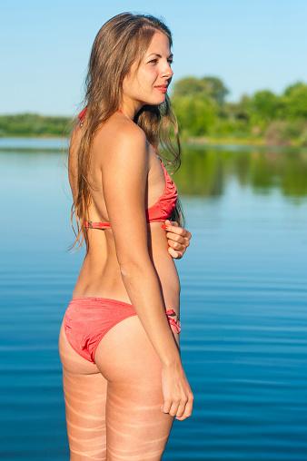 1155046257 istock photo Girl in bikini on lake background 485492382