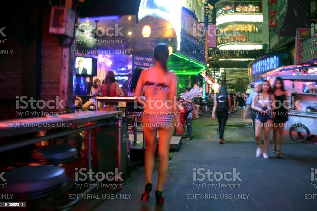 Girl in Bikini walking on Soi Cowboy strip, Bangkok, Thailand stock photo