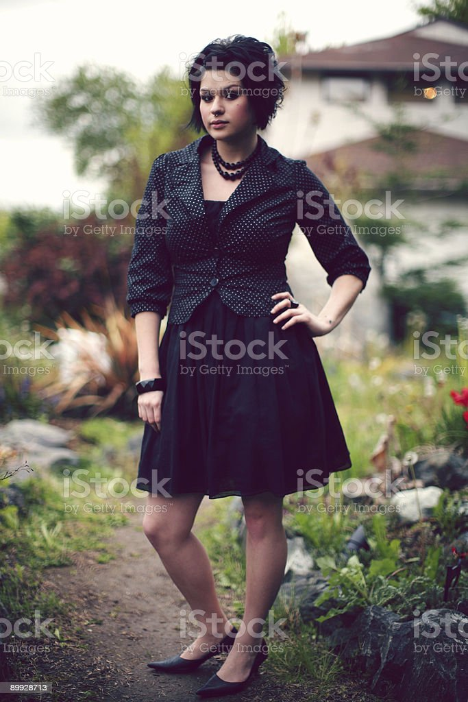 Girl in Black Dress Standing on a Trail royalty-free stock photo