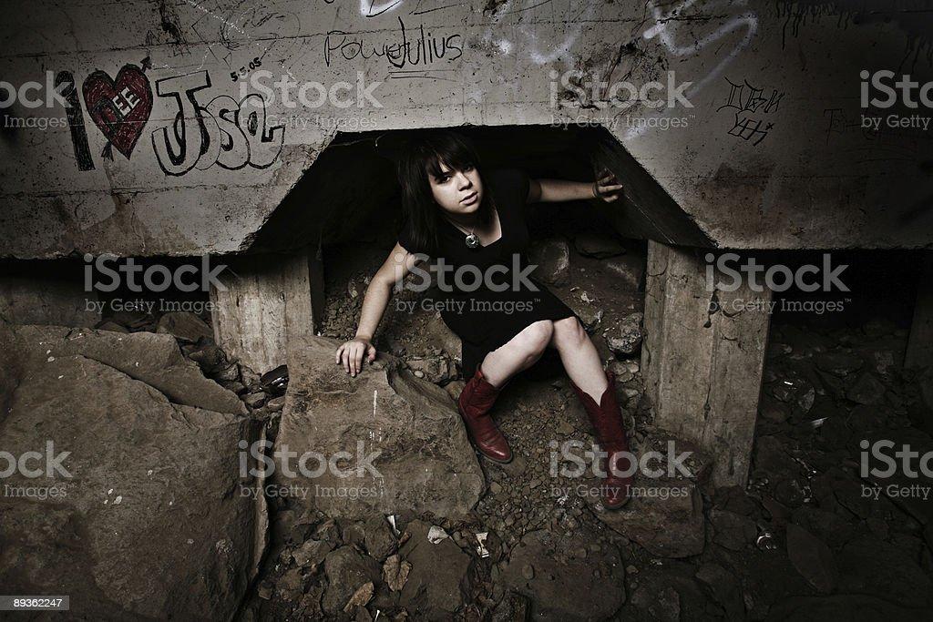 Girl in Black Dress Under a Bridge stock photo