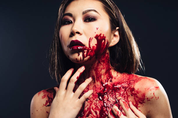 girl in blood makeup stock photo