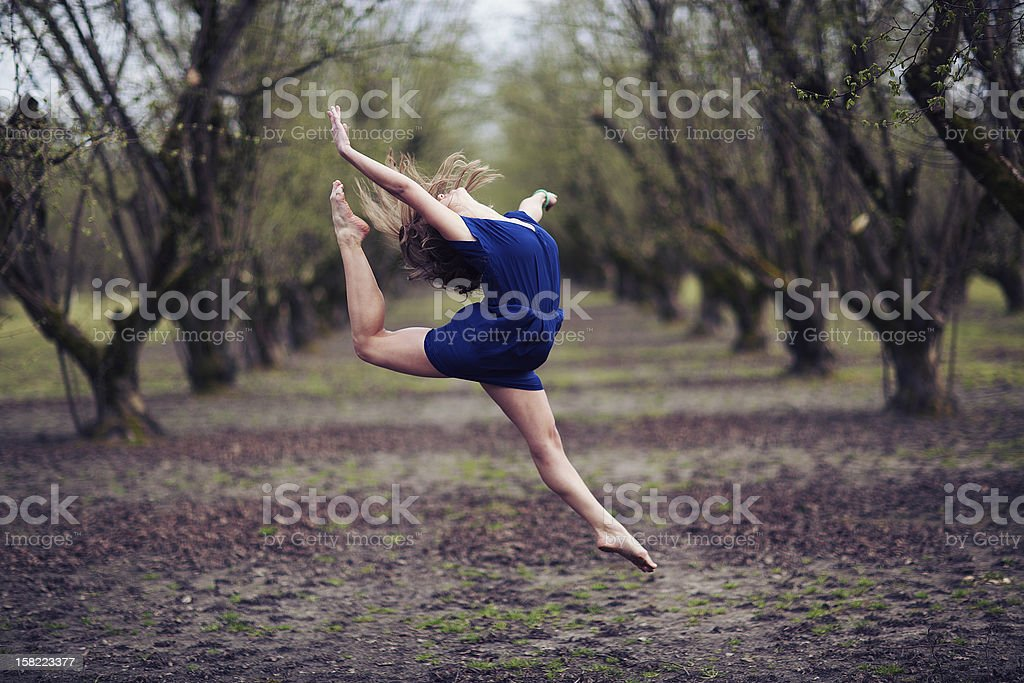 Girl in Blue Dress Striking a Dance Pose royalty-free stock photo