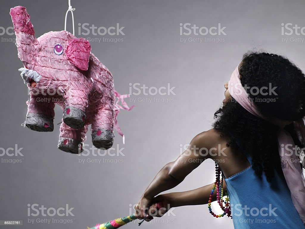 Girl in blue dress with elephant pinata royalty-free stock photo