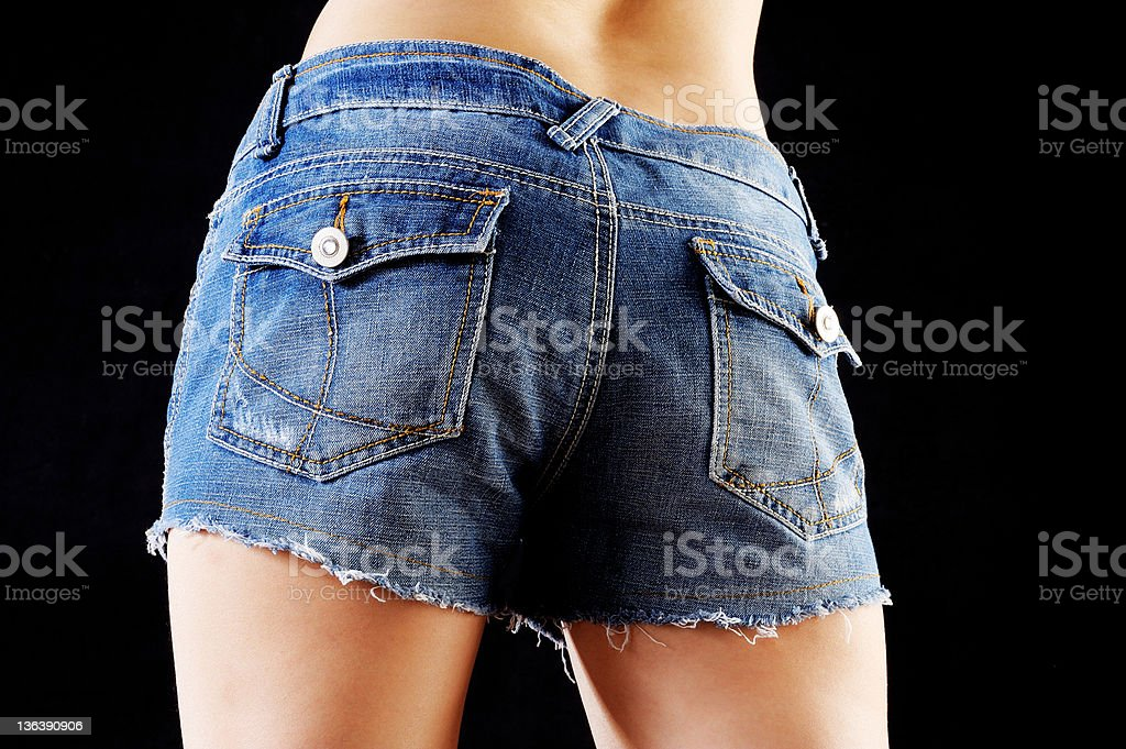 Girl in blue jeans short stock photo