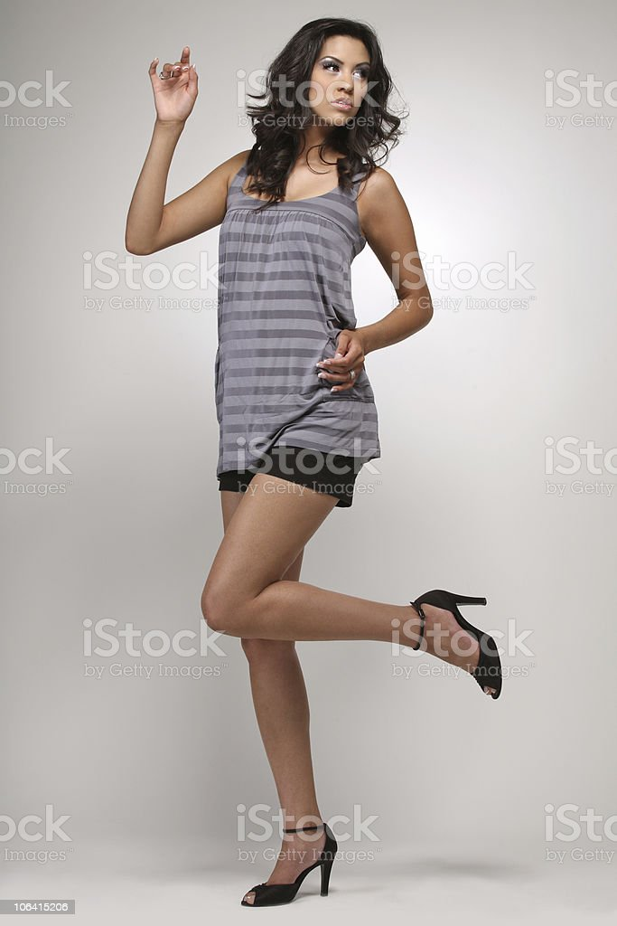 Girl in blue shirt and shorts. royalty-free stock photo