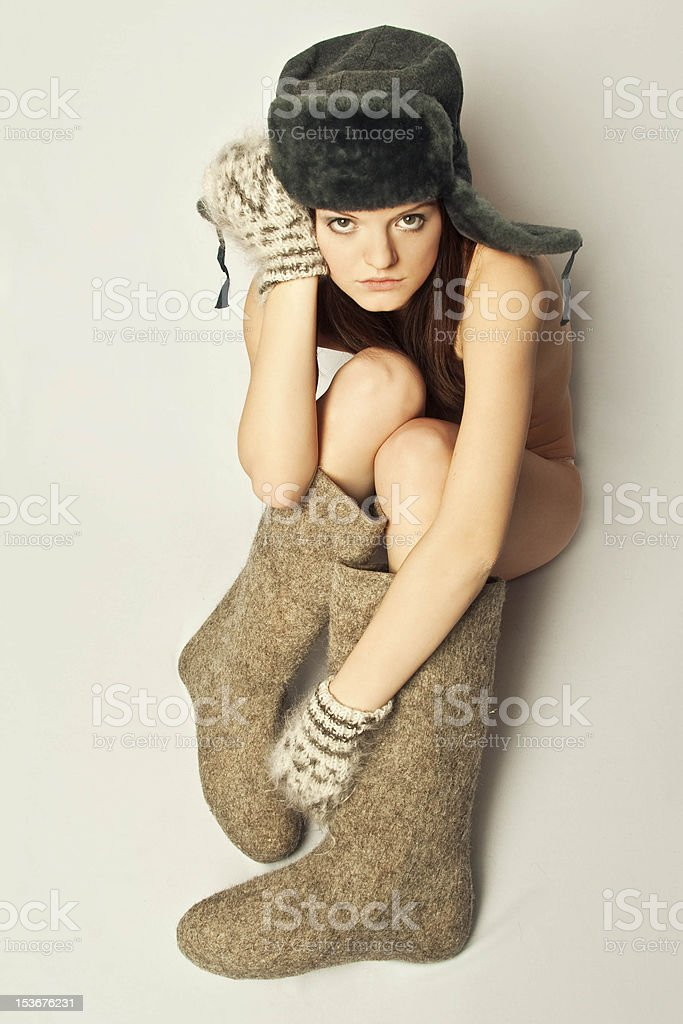 Girl in boots and a fur hat, winter stock photo