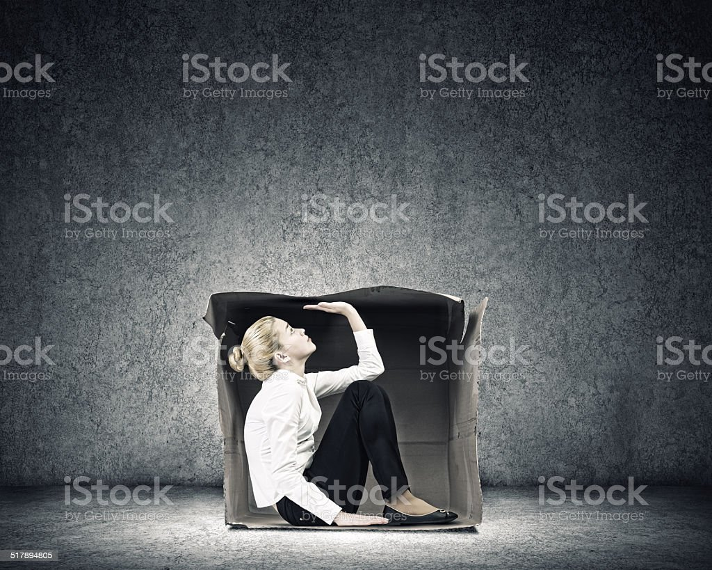 Girl in box stock photo