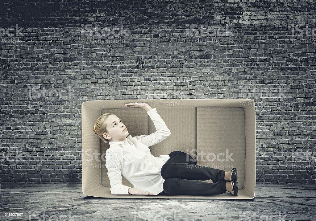 Girl in box stock photo