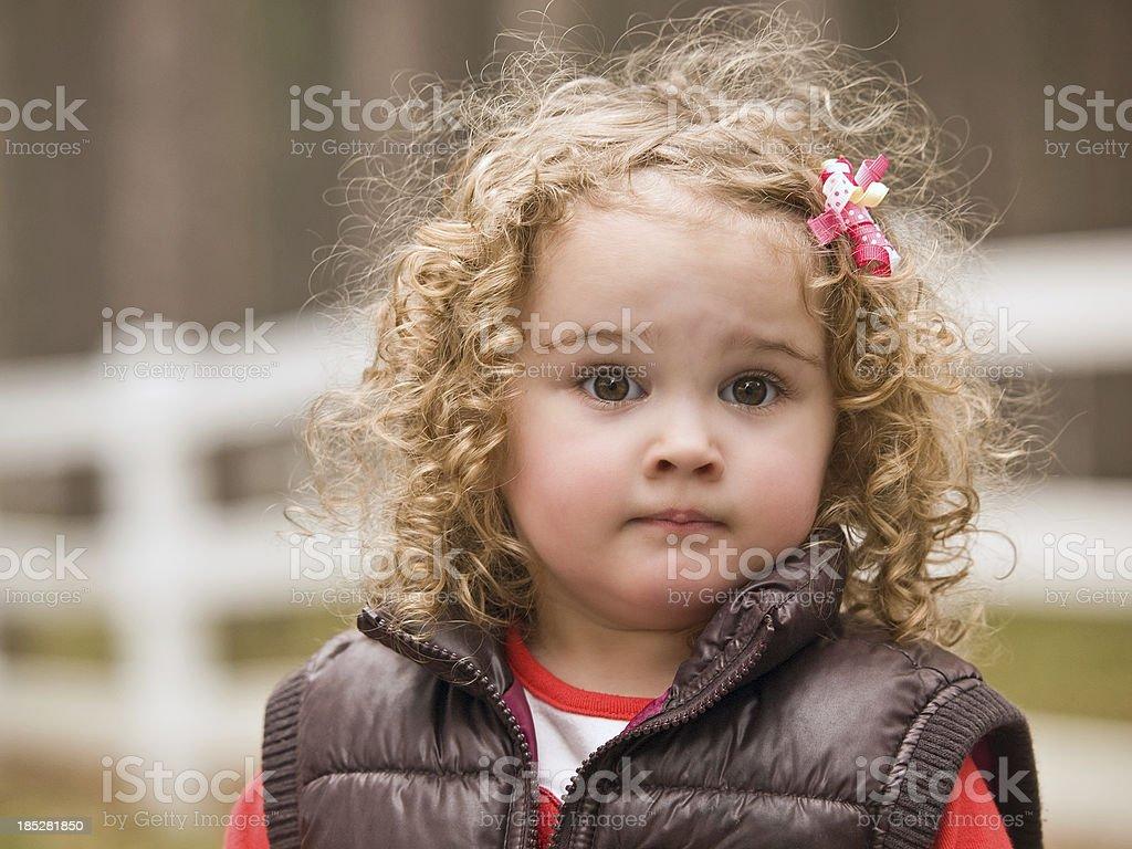 Girl in Brown Vest royalty-free stock photo