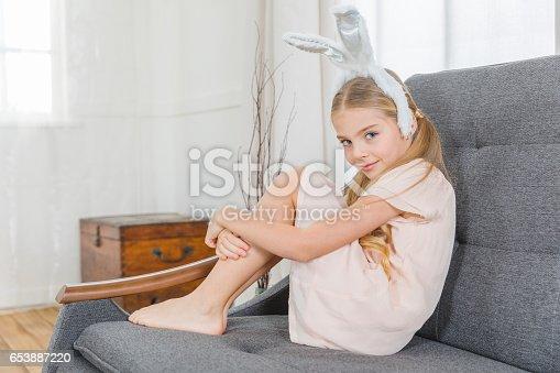istock Girl in bunny ears 653887220